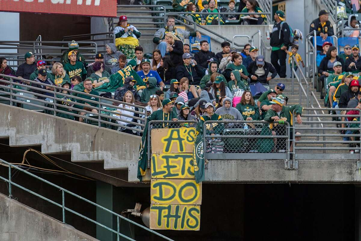 OAKLAND, CA - JULY 03: Oakland Athletics fans root for their team during the Major League Baseball game between the Minnesota Twins and Oakland Athletics on July 3, 2019 at O.co Coliseum in Oakland, CA. (Photo by Bob Kupbens/Icon Sportswire via Getty Images)