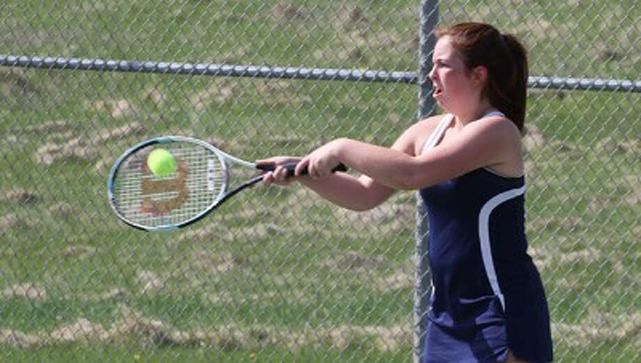 Manistee's Marina Garber returns a shot during her No. 1 singles match in Big Rapids on Tuesday. (Martin Slagter/Pioneer News Network)