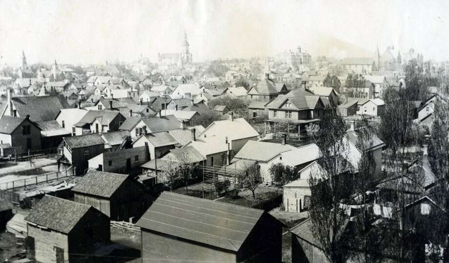 This photograph shows an expansive view of Manistee circa 1890s.