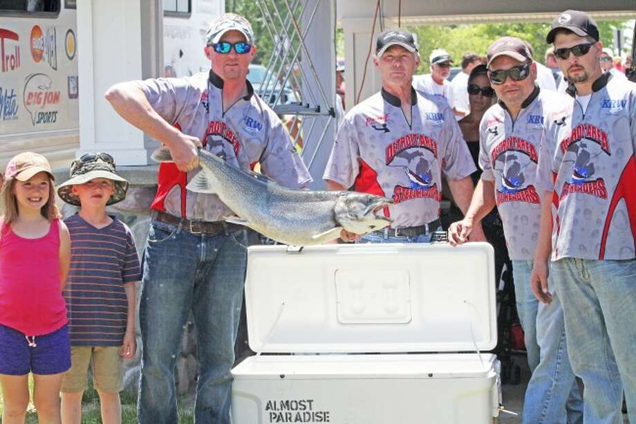 The Almost Paradise team caught the biggest fish in the Budweiser Pro/Am fishing tournament on Sunday, a Lake Trout weighing in at 21.8 pounds. From left, Lily Paradise, Luke Paradise, Mark Paradise, Bob Paradise, Tom Thieda and Mike Paradise.