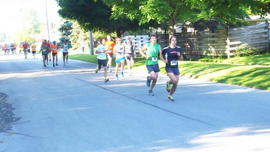 More than 300 people participate in the annual Firecracker 5K road race and 1K fun run during the Manistee National Forest Festival.