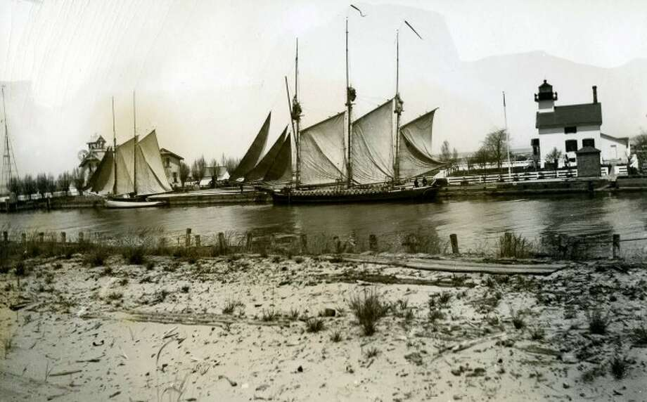 Lake vessels loaded with lumber in the Manistee Harbor circa 1890 are shown in this historic photograph.