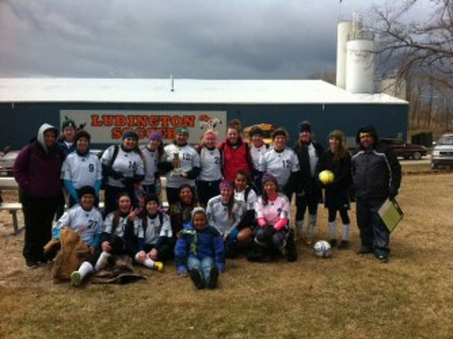 The Manistee soccer team poses with its second-place trophy after finishing 2-0-1 in the Ludington Invitational on Saturday. (Courtesy Photo)