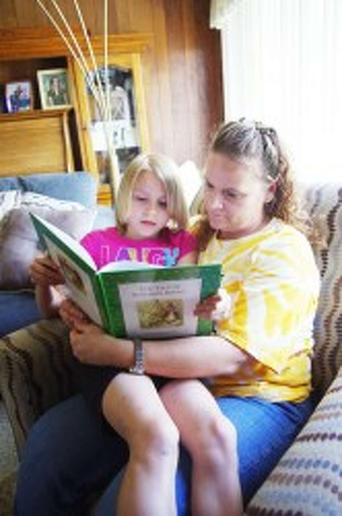 READING TIME: Janeen Codden and her daughter Raegan have been catching up on their reading -- something they couldn't do for the year that Janeen was deployed to Afghanistan as a member of the Michigan Army National Guard.