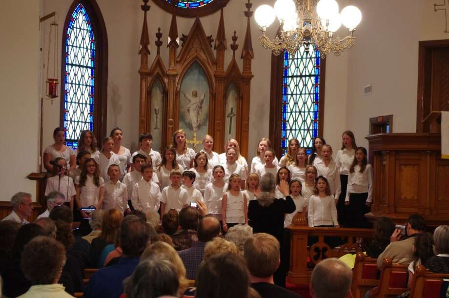 Joy Smith leads the Manistee Benzie Area Children's Chorus as they sing in their spring concert that was held Saturday evening at Trinity Lutheran Church in Arcadia. (Dave Yarnell/News Advocate)