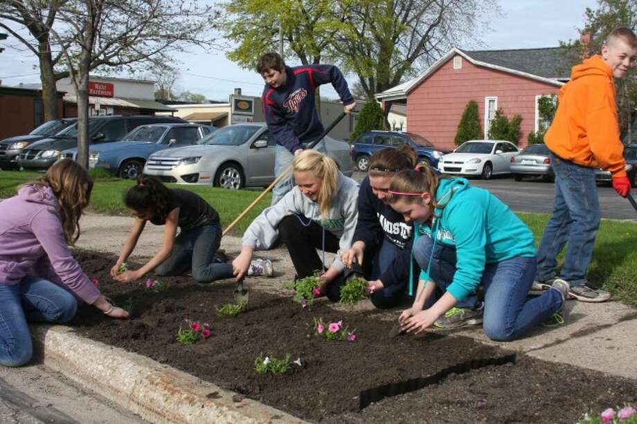 Students from area schools assisted in the planting of the Your Blossom Boulevard on Wednesday.