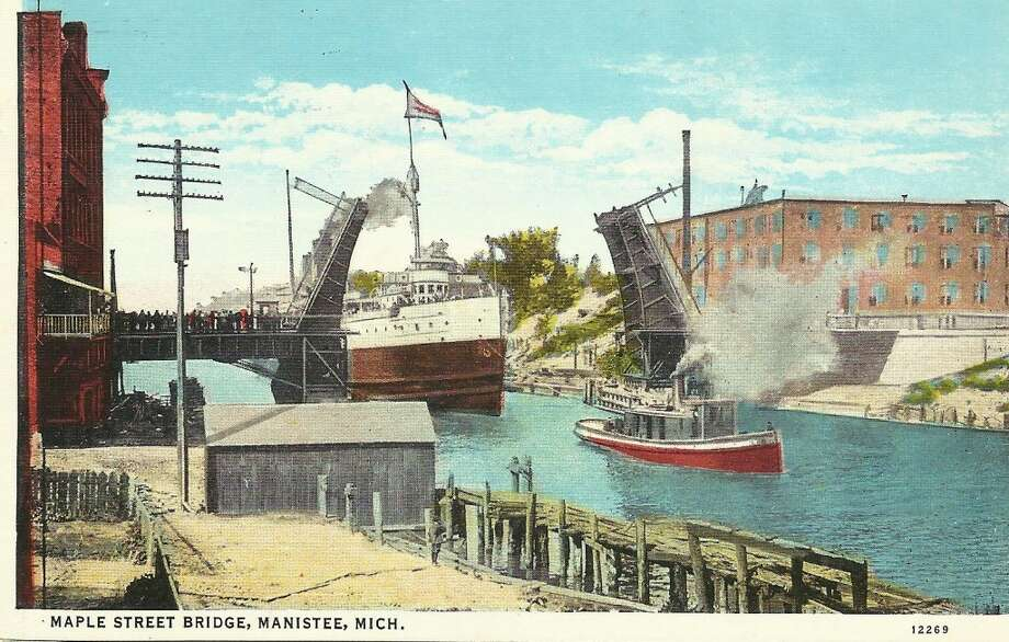 An early 1900s photo looking westward as a ship goes through the Maple Street Bridge in Manistee. (Courtesy Photo/Dale Picardat)