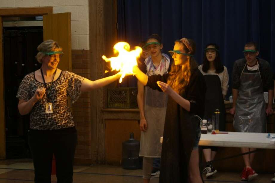 Students from Manistee High School earned more college credits in Advanced Placement classes then they ever have in the past. Students earning college credits while still in high school is becoming a common thing at all area schools. Shown are students from the AP Chemistry class putting on a demonstration for elementary students.