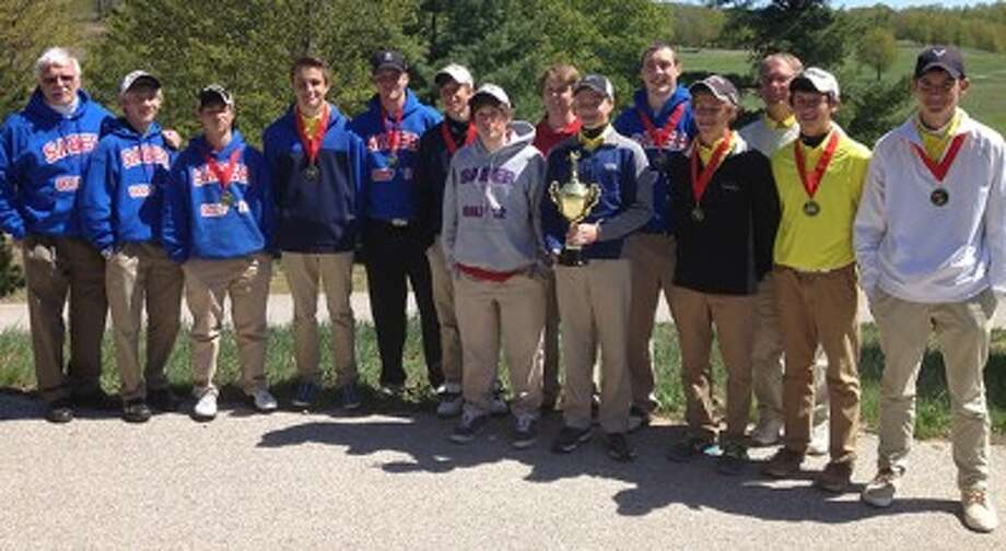 The Manistee Catholic Central and Manistee golf teams pose with their hardware after the Benzie Invitational on Monday. (Courtesy photo)