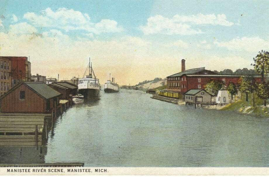 An early 1900s view looking toward Lake Michigan at the west end of the Manistee River Channel. (Courtesy Photo/Dale Picardat)