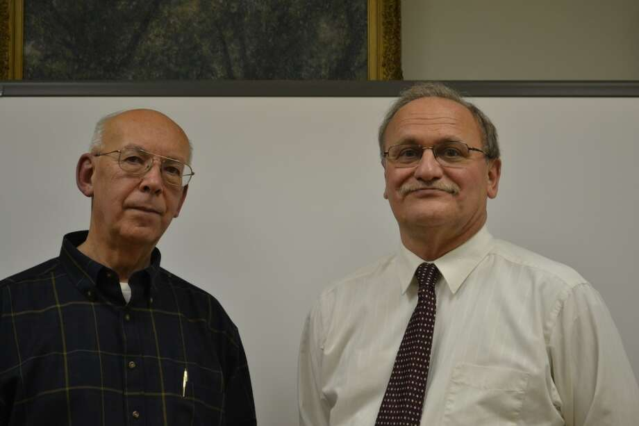 Manistee County Library Board President John Faher (left) and Manistee County Library Executive Director Chuck Haemker are moving ahead with the process of replacing the heating and cooling system in the main building on Maple Street. (File Photo)