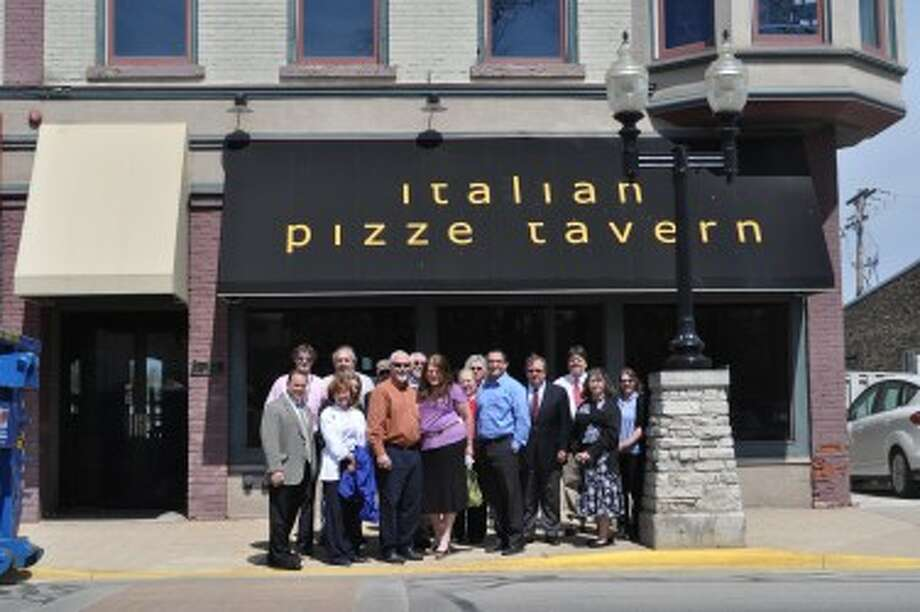 Chuck and Connie Freiberg officially purchased 312 River St. on Tuesday to serve as the future site of the Blue Fish Kitchen & Bar. Members of various agencies that were involved in the nine-month process came together to celebrate the sale on Tuesday.