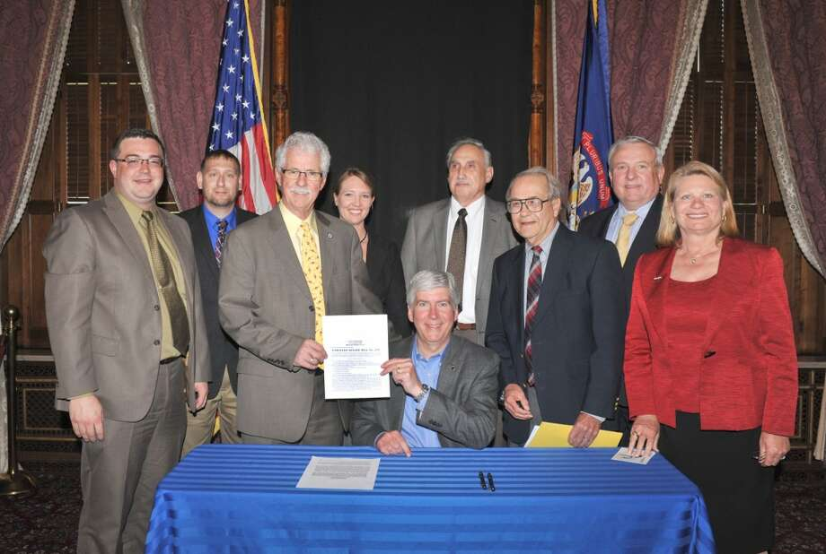 Sen. Darwin Booher, R-Evart, and Rep. Ray Franz, R-Onekama, join Gov. Rick Snyder as he signs Booher's legislation allowing honorably discharged veterans to add a special veteran designation to their driver's licenses or state-issued ID. Pictured with Gov. Snyder from left: Booher's chief of staff Patrick Tiedt; Booher's constituent relations director Thomas Smith; Sen. Booher; Booher's legislative director Kara Butters; Vietnam War veteran Len Corsetti of Sanilac County, US Army; Dr. Richard Santer of Big Rapids, 1st Lt. 2nd US Army Missile Command Medium; Rep. Franz; Secretary of State Ruth Johnson.(Courtesy photo)