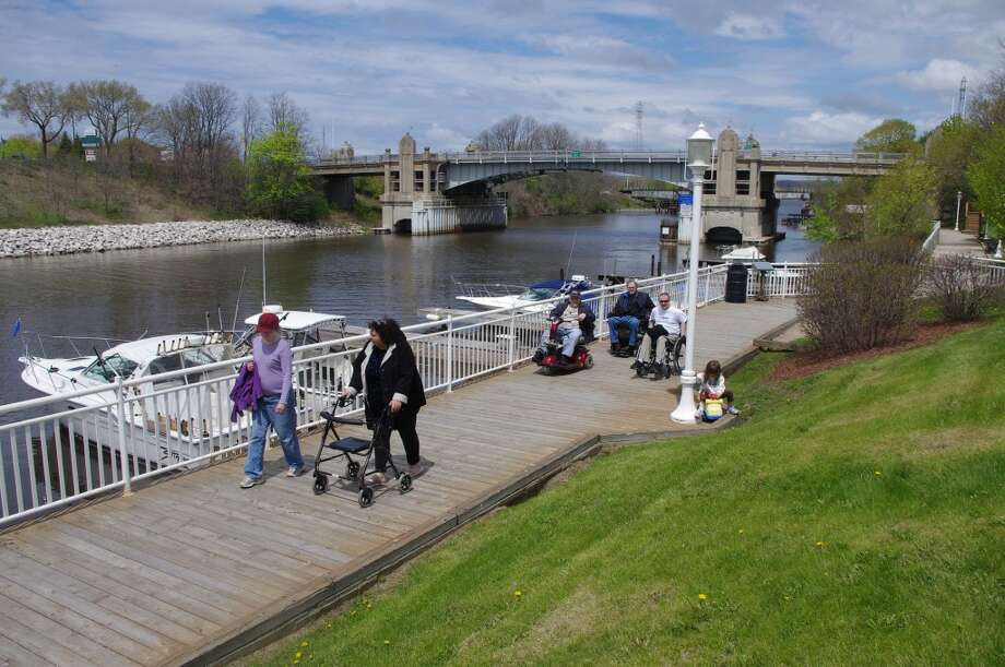 """This year's """"Walk and Roll"""" event on the Manistee Riverwalk during Healthy Active Manistee Week is sponsored by the Manistee Chapter of the National Association of Physically Handicapped and dedicated to the memory of long-time NAPH member Richard Knechtges Jr. (News Advocate File Photo)"""