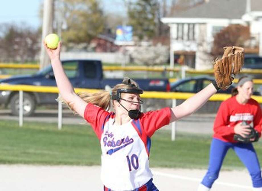 Manistee Catholic Central's Sydney Arendt delivers a pitch during the second game against Baldwin on Thursday. (Matt Wenzel/News Advocate)
