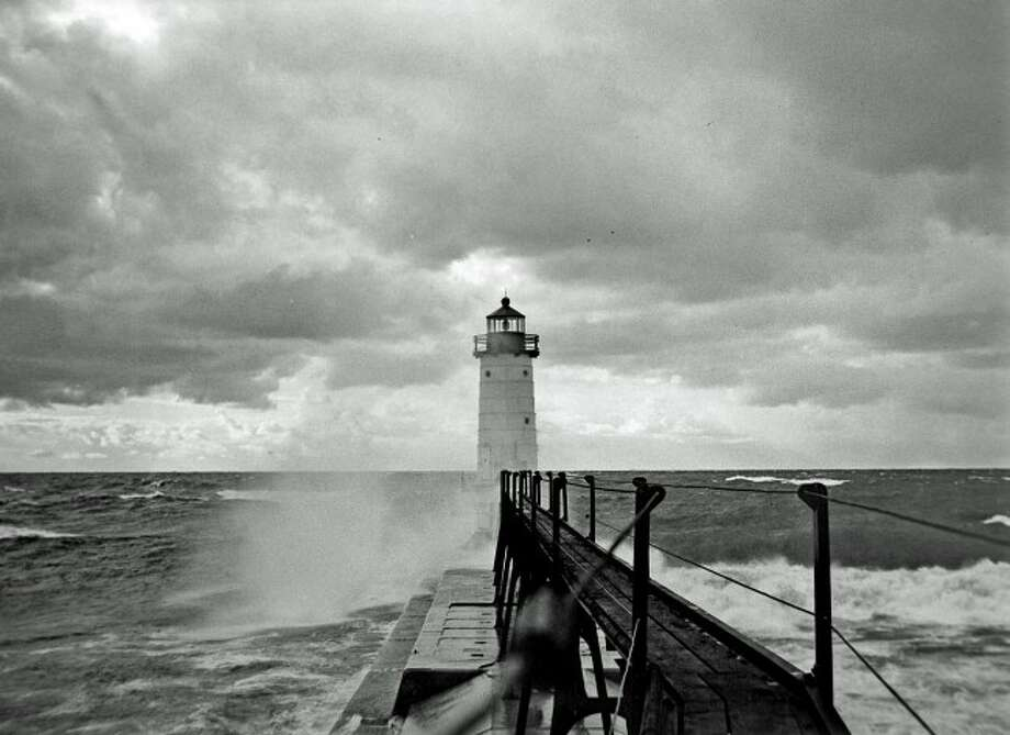 The north pierhead lighthouse at Fifth Avenue beach is shown in this 1940s photograph from the catwalk.