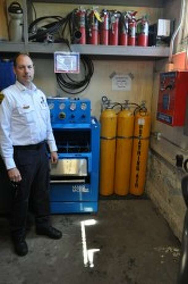 Heath Darling, Manistee Fire Department deputy chief, shows off the department's current cascade filling system, which can not keep up with the new high-capacity air tanks. Thanks to a $52,590 FEMA grant, the department is in the process of upgrading its cascade system to a more suitable fit.