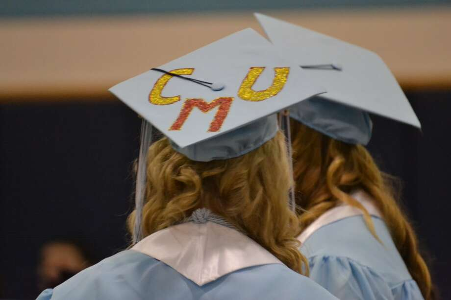 Brethren High School Class of 2013 graduates decorated their mortarboards with letters and symbols representing their next step in life: college, the military or the workforce. This senior woman is heading for Central Michigan University. (Meg LeDuc/News Advocate)