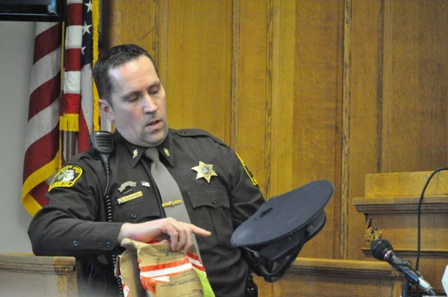 Mason County Sheriff's Office Chief Deputy Steve Hansen logged evidence at the scene of Michigan State Police Trooper Paul Butterfield's death on Sept. 9, 2013. On Wednesday, he showed Butterfield's garrison hat with a bullet hole in the top to the jury in the trial of Eric Knysz.