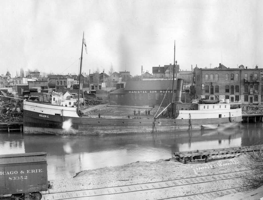 Looking south across the river channel near the corner of River and Division in early 1900.