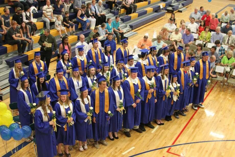 The Onekama High School class of 2013 proudly stand as a unit for the start of commencement exercises. Thirty-two graduates were presented diplomas at the ceremony.