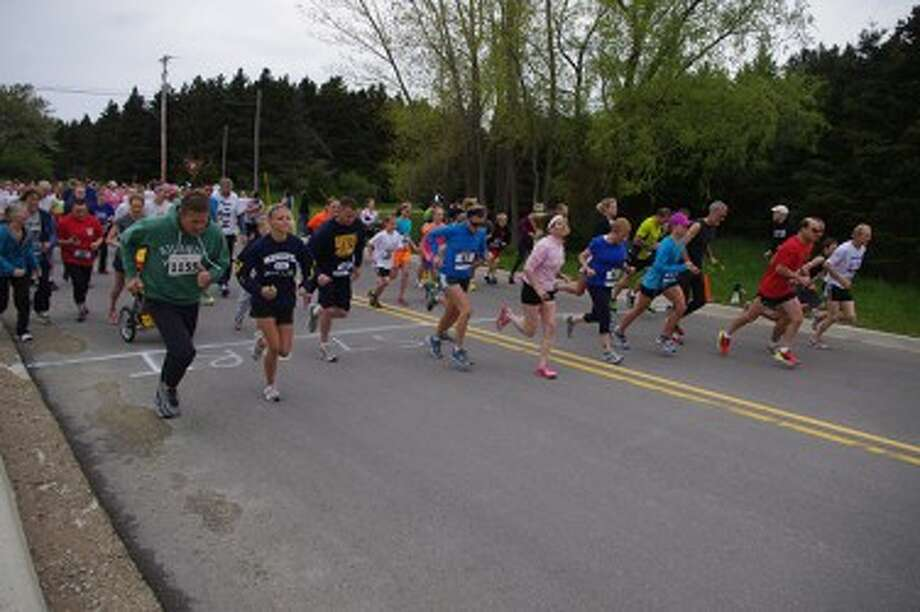 Racers take off on Saturday for the start the fourth annual H.A.M. it Up 5k. (Dave Yarnell/News Advocate)