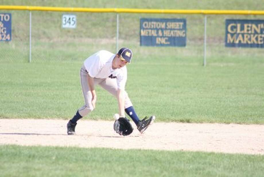 Manistee's Mason Swidorski delivers a pitch in the first game of Saturday's home tournament. (Matt Wenzel/News Advocate)