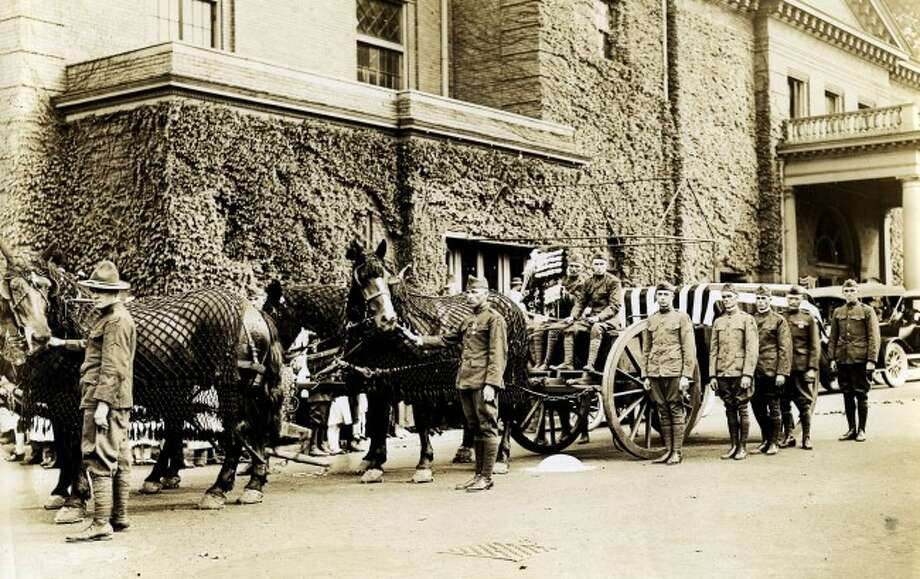 A military procession readies the caskets of Lt. Harold King and Cpl. Edwin Larsen in Sept. 1921 who both lost their lives in World War I in 1918. The parents of both men decided to have a double military funeral for the two soldiers whose remains were brought back to Manistee together. The double funeral took place at the Ramsdell Theatre.