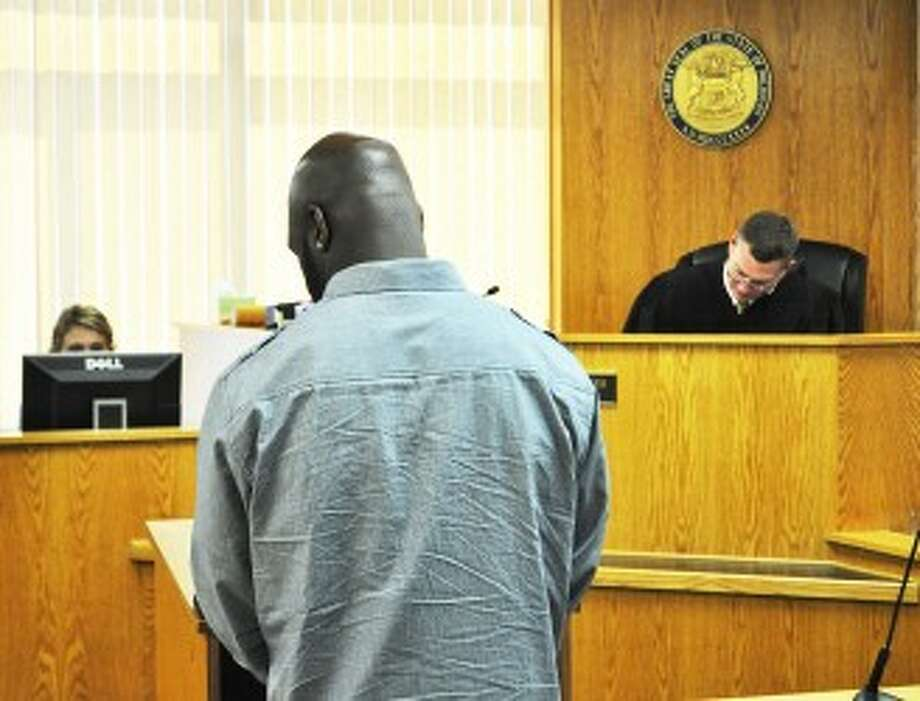Kareem Jabalt Gaskew (left) waived his right to a preliminary examination on Tuesday in Manistee County's 85th District Court. He was bound over to circuit court.