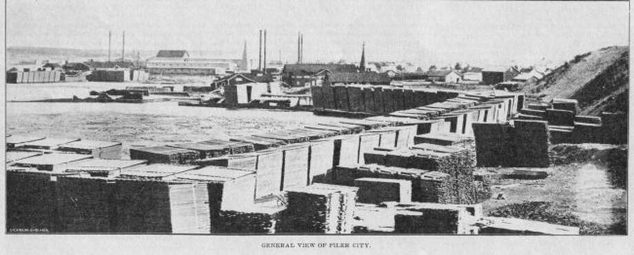 Filer City was shown filled with lumber during the height of the lumber era in Manistee.