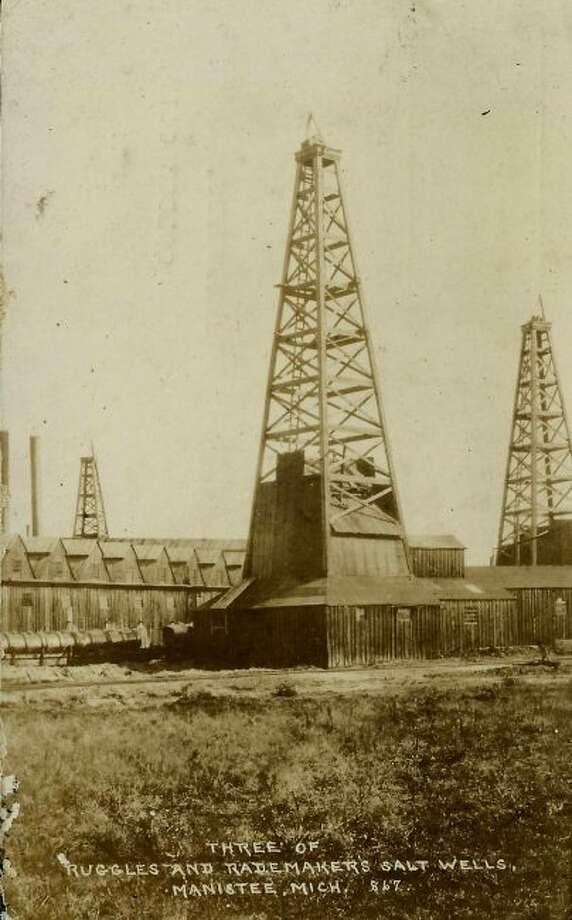 Three salt wells from the Ruggles and Rademaker salt plant are shown in this 1890s photograph.