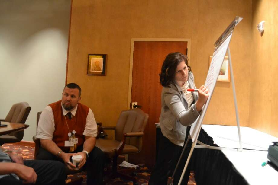 Jami Klomp (RIGHT) of the Alliance for Economic Success writes ideas on an easel as Manistee County Commissioner Karl Waitner and others brainstorm. Leaders of Manistee County are beginning a strategic planning process facilitated by AES. (Meg LeDuc/News Advocate)