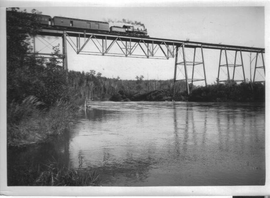 A train crosses the Highbridge Railroad bridge in the late 1800s. The bridge was a vital part of the county transportation system.