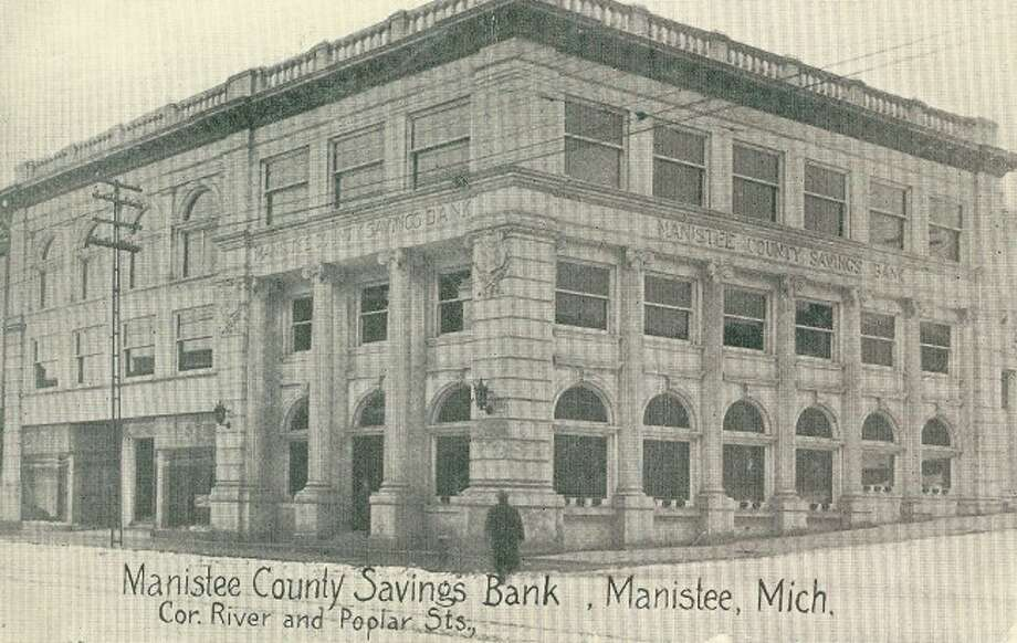The Manistee County Savings Bank at the corner of River and Poplar streets is shown in this 1912 photograph.