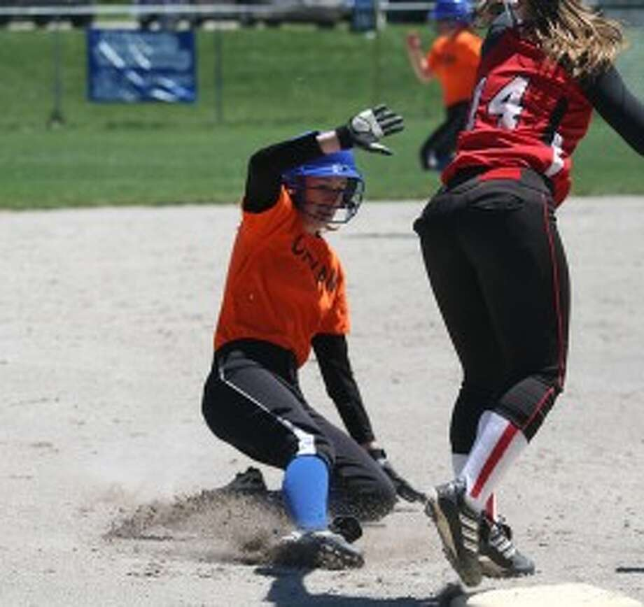 Onekama's Kaylan Fitch slides safely in to third on Friday. (Dylan Savela/News Advocate)