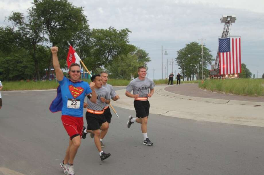 The Running with the Soldiers 5K was held on Saturday in Manistee with members of the 126 Bravo Unit. The run was dedicated to the memory of Sgt. Michael Naef who was killed in a car accident just prior to their deployment to Afghanistan. Since Naef was nicknamed Superman runners were encouraged to dress up like a super hero or as Superman for the run.