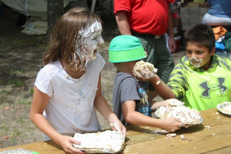 Avery and Adam Raney and David Picard get into the children's pie eating contest at Kaleva Days.
