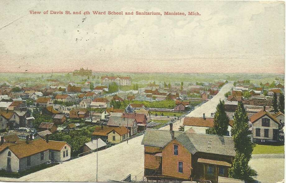 An early 1900s post card view looking southeast along Davis Street in Manistee. (Courtesy Photo/Dale Picardat)