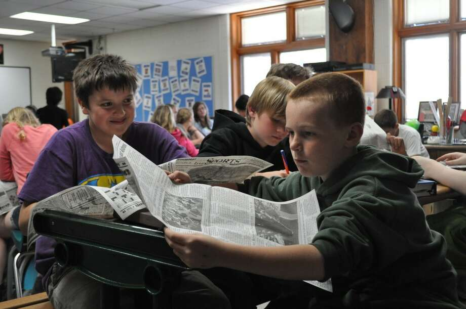Ricky Garcia and Brayden Alfman read the Manistee News Advocate during teacher Jeff Harthun's Newspapers in Education lesson on May 15.