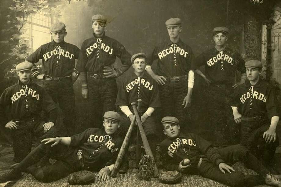The Manistee Records baseball team of 1903 were: Back row Fritz Oelke, Uri Lundbom, Howard Johnson and Harry Merkey. Center row left to right August Hauck. Kneeling left Louie Lorenz, Ole Petersen. Front row left Otto Eckhoff and John Niesen.