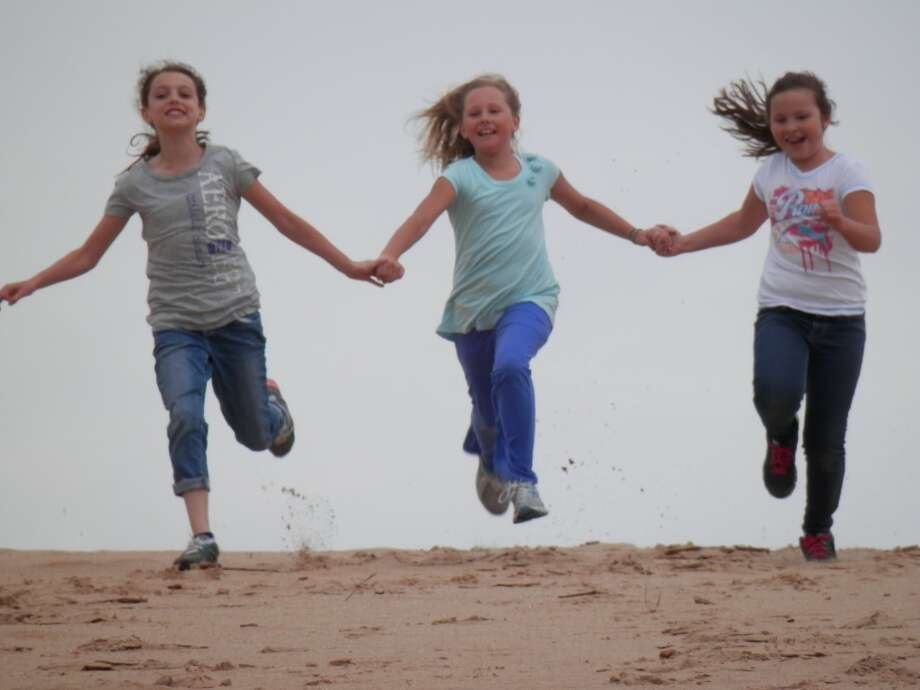 Sophie Wisniski, Ellery McIsaac and Ashley McGrady take flight.(courtesy photo)