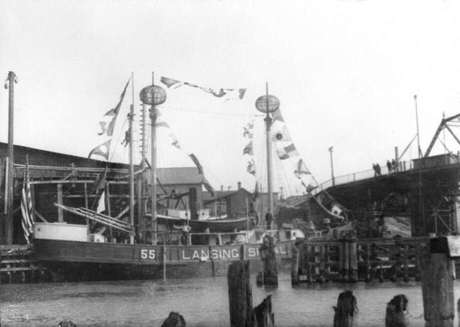 This picture from the 1890s shows a busy Manistee River Channel filled with boats docked along the banks.