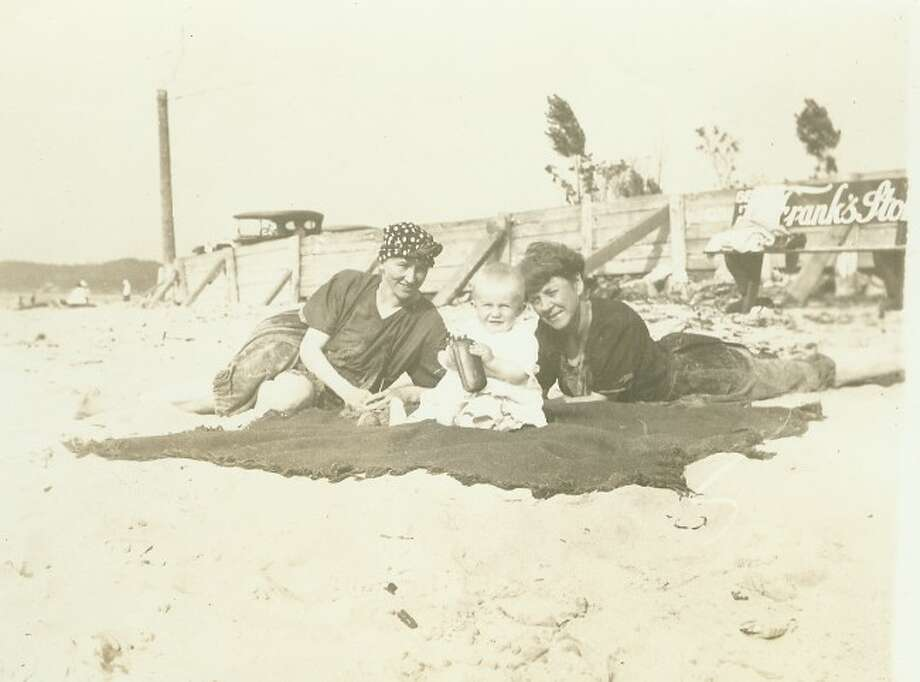 People enjoy a warm spring day at the beach in this 1920s picture.
