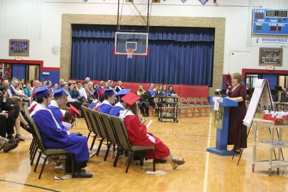 Manistee Catholic Central commencement speaker Jan Bigalke gives her former students one final lesson at the graduation ceremony. Bigalke is a former teacher and principal at the school.