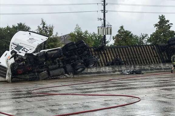 An overturned 18-wheeler closed parts of U.S. 59 in Fort Bend County on Monday.