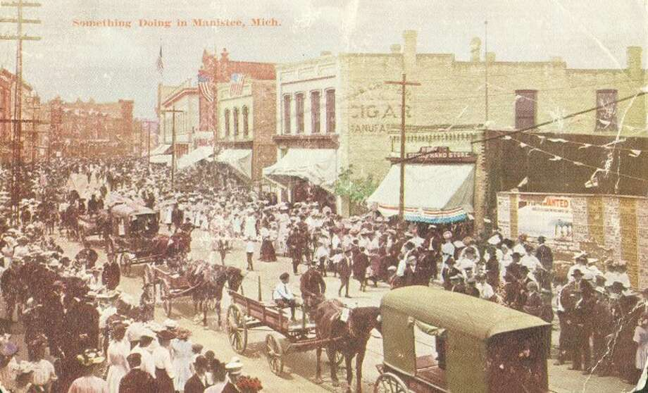 River Street is bustling with activity in this 1890s photograph from the Fourth of July.