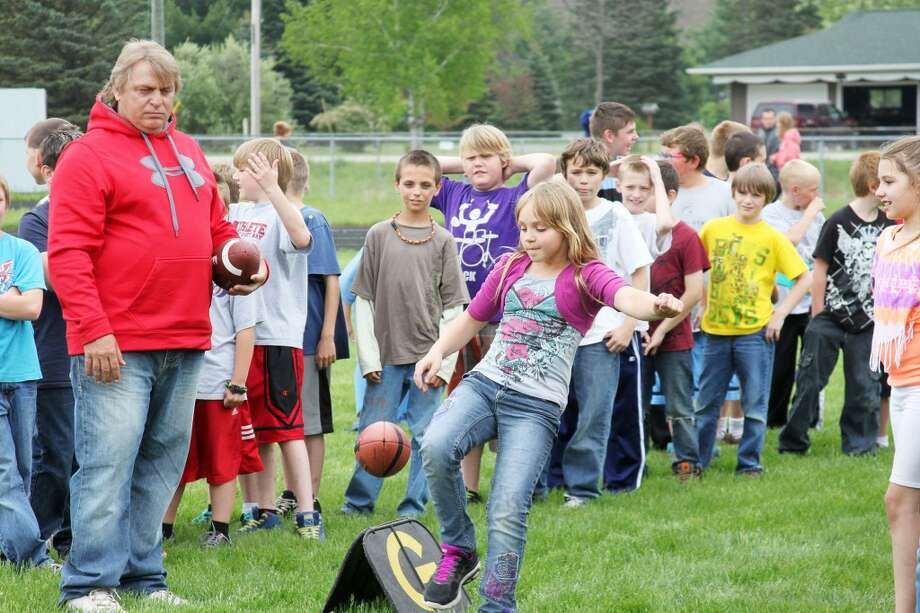 Concentration was the key to the punting competition and keeping their eye on the ball during the Fuel Up to Play 60 program at Brethren schools.