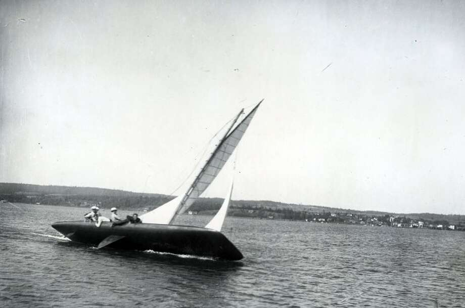 Pleasure seekers sail a yacht on Portage Lake in Onekama in 1901.