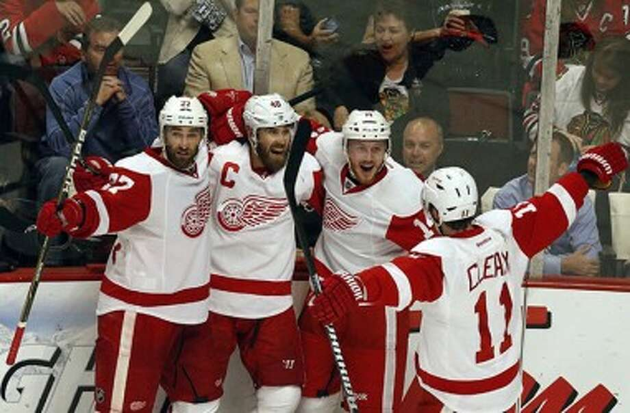 Wings forward Henrik Zetterberg (40) celebrates his goal against Chicago with teammates on Wednesday. (Julian H. Gonzalez/Detroit Free Press/MCT)