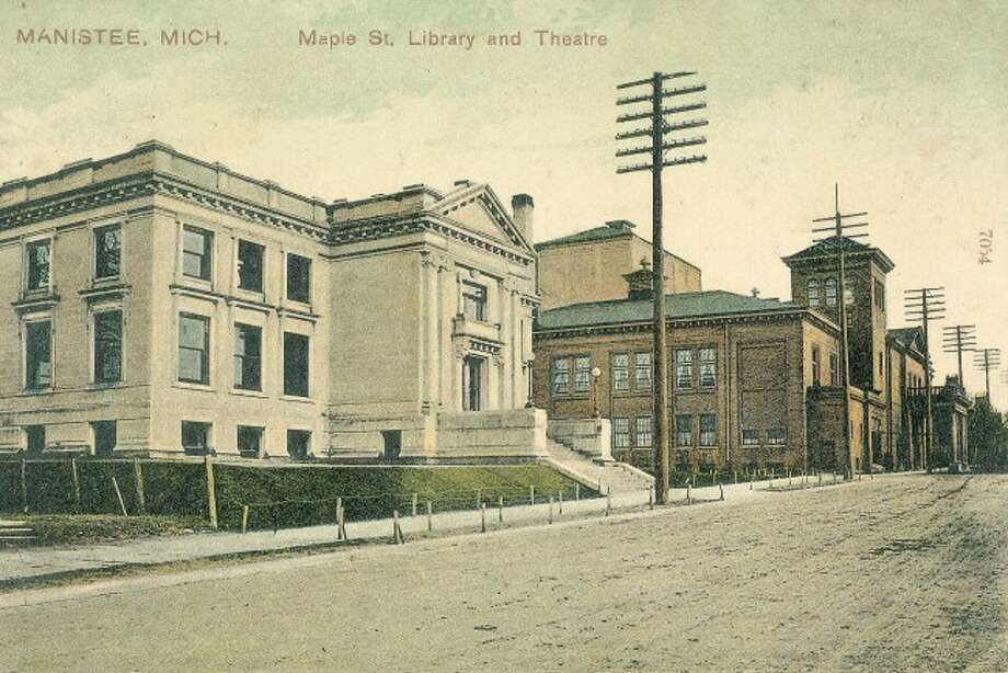 Maple and First streets weren't even paved at the time this early 1900 picture was taken of the Manistee County Library and Ramsdell Theatre buildings.